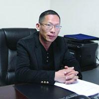 加快旅游资源的综合开发――访区人大代表李浦军