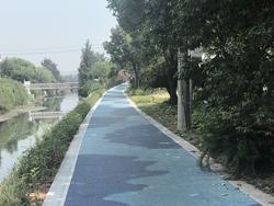 """蓝色""""波浪""""涌至玉坎河边 4000米游步道让人耳目一新"""