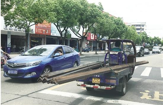 车载铁条影响交通