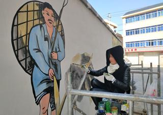 彩绘上墙扮靓边贸特色小镇