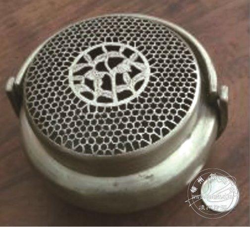 被人搁置的取暖器具:铜手炉