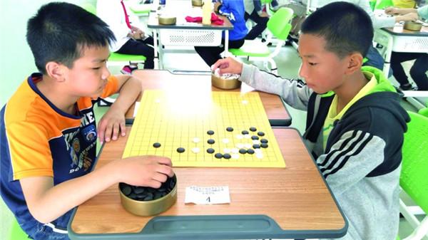 龙游举行阳光体育运动会围棋比赛
