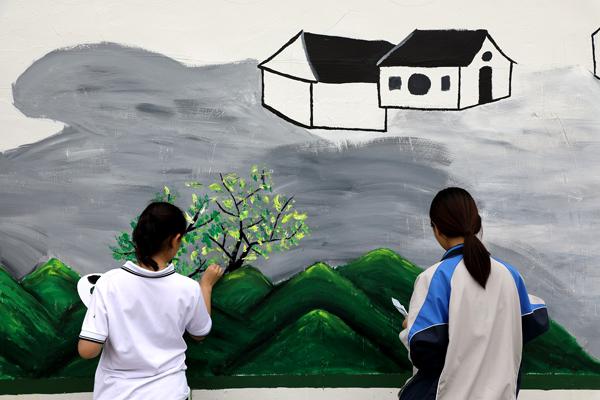 楚门:手绘墙画扮靓美丽乡村